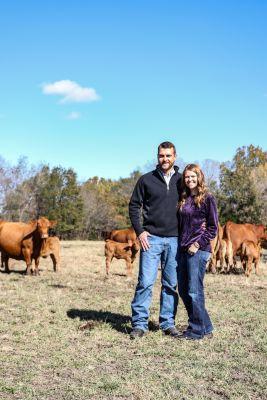 Brandi Buzzard with her husband on their cattle farm.