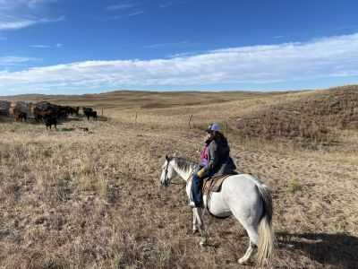 Brandi Buzzard with her daughter on horseback